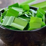 Pandan leaf in a cup on wood